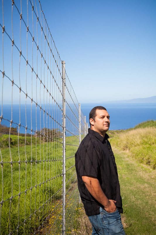 Kanalu Sproat standing by a new deer fence on the Ulupalakua Ranch.